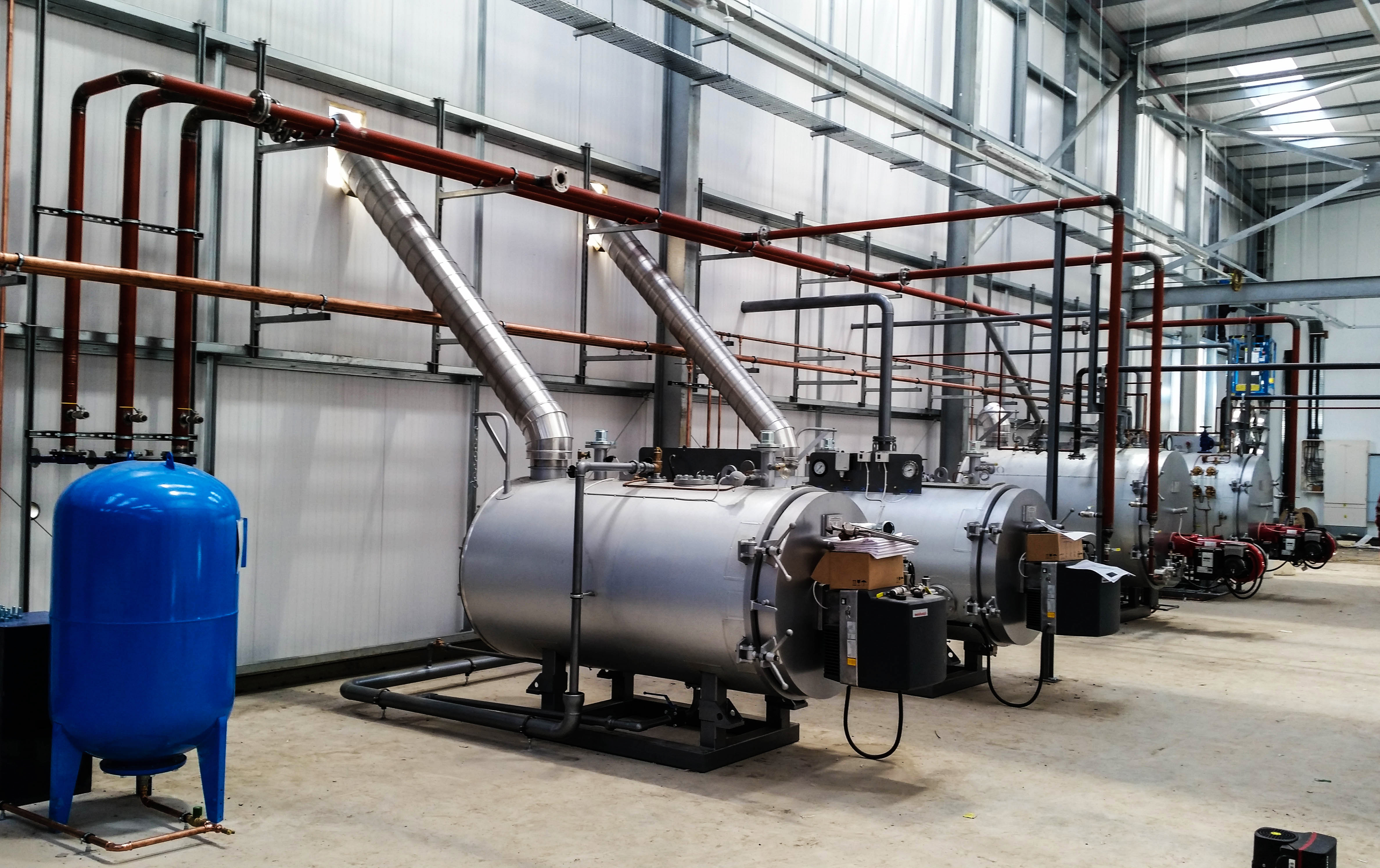 Work in progress photo of full boiler house installation. Scope of works for design, manufacture, installation and commissioning of 2 x Byworth Fellsman 500kW hot water boilers & 2 x Byworth MX1000 (1000kg/hr) steam boilers, hotwell, blowdown vessel, steam distribution header & all associated interconnecting pipework. All manufactured from start to finish in UK